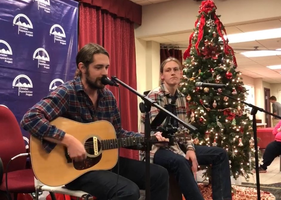 Nick Jamerson of Sundy Best and brother Joseph sing Christmas music for children and families at Christian Appalachian Project's 2017 Christmas Basket Distribution