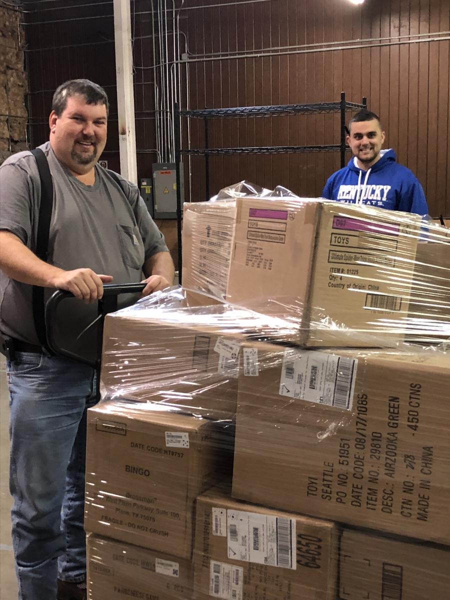Wesley Howard, Christian Appalachian Project (CAP), collects donated toys from Josh Hager, Happen Stock Toys, to deliver to CAP's Operation Sharing warehouse in Corbin. The toys will be distributed to children in need in Appalachia.