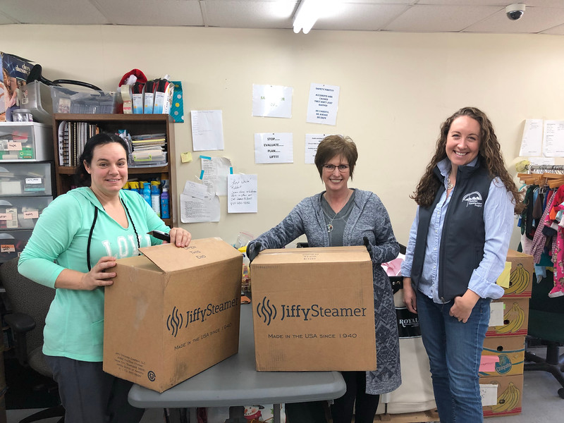 Amanda Gadd, Sherri Barnett, and Bridget McCormack with two brand-new steamers donated by Jiffy Steamer in Union City, TN.