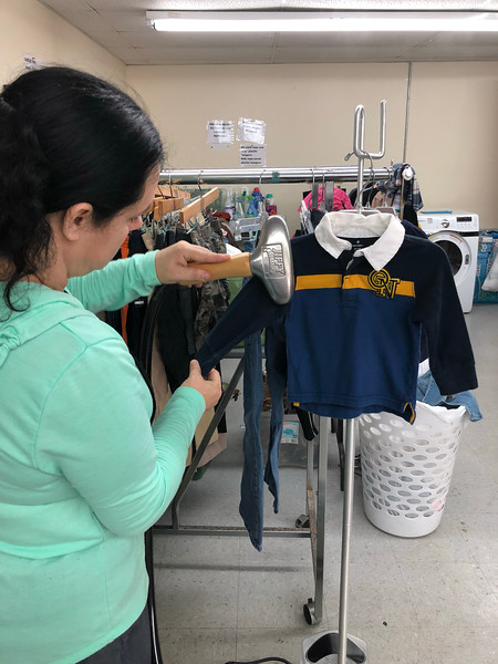 Amanda Gadd, a community volunteer, uses the new Jiffy Steamer to prepare donated clothing to go on the sales floor at Grateful Threadz Thrift Store.