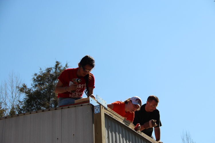 Skilled CAP crew leaders work side by side with WorkFest volunteers