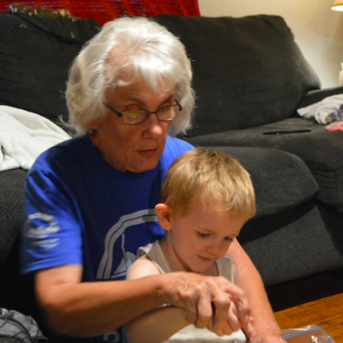 Suzann Fenton works with a child to help develop his sensory skills